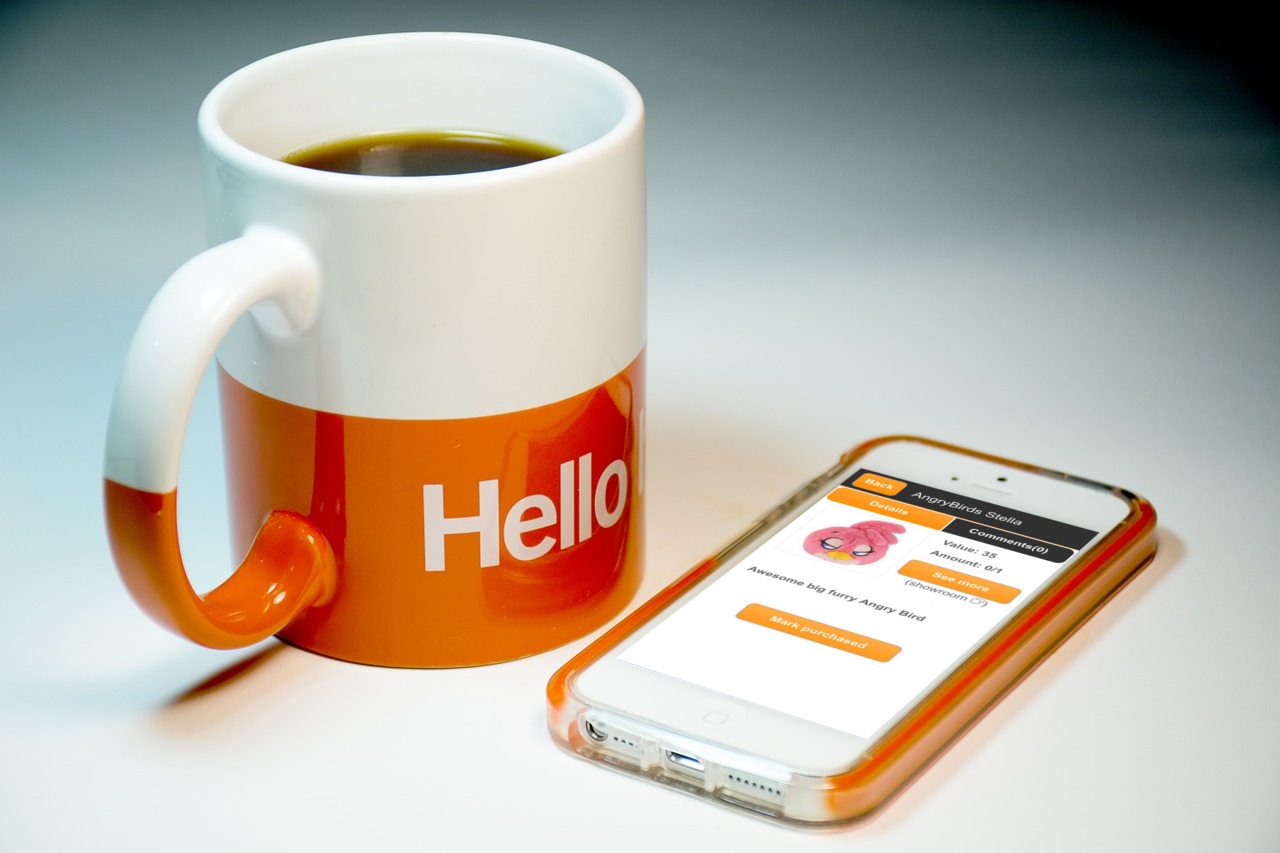 Cup with hello text and Mobile phone with WishSimply app